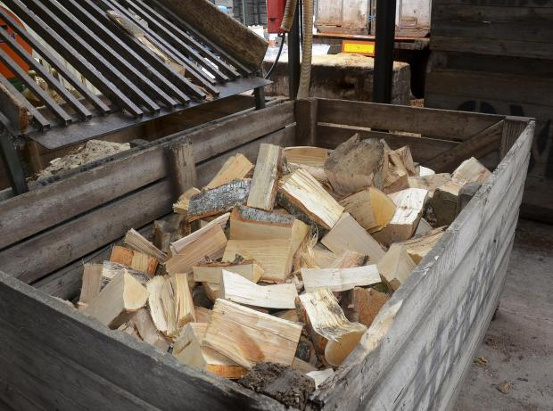 Forestry Journal: Old potato crates store the cut and dried logs for just over twelve months.