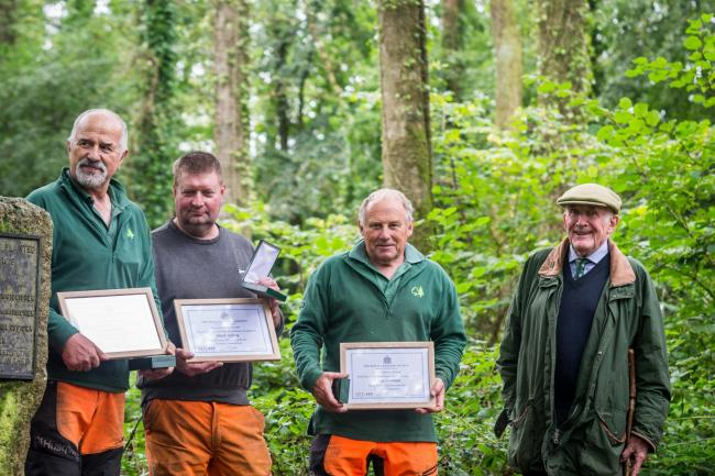 From left: Clive Hunt, Mark Jeffery and Simon Tremain, with Lord Clinton, past president of the Royal Forestry Society, who presented the awards.