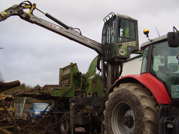 Forestry Journal: The elevated cab offers the operator a clear view when feeding the chipper by crane.