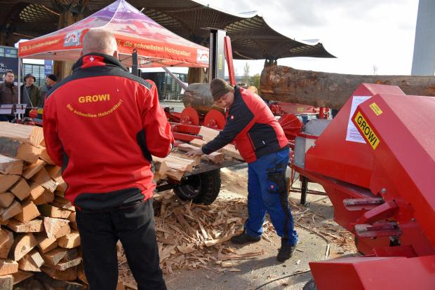 Forestry Journal: Growi staff demonstrating firewood processing equipment.
