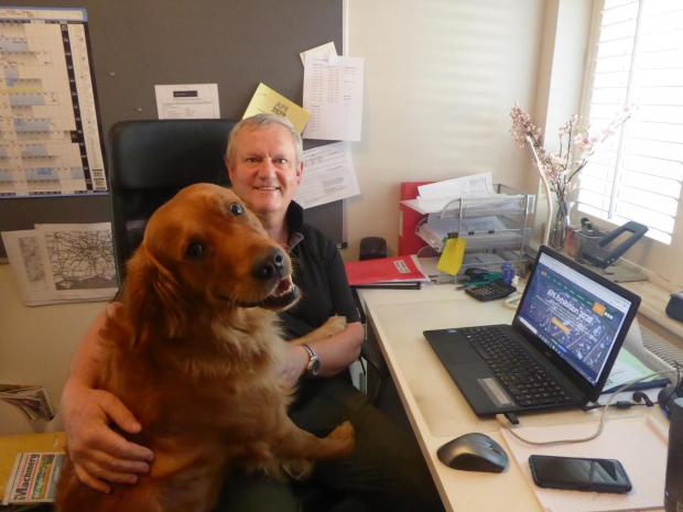 Forestry Journal: Ian in his office with golden retriever Remi.
