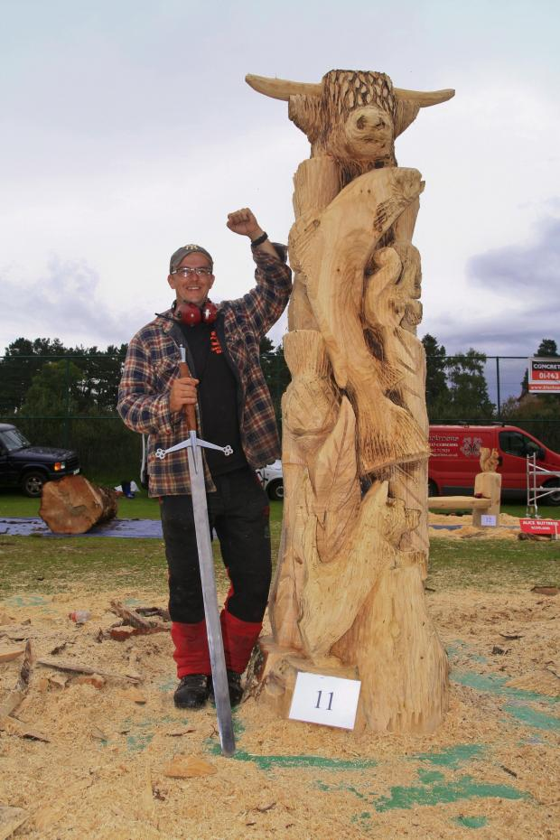 Forestry Journal: The Scottish Totem Pole, which had a westie, salmon, squirrel, thistles and a big coo on top of it. This carve was the winner at Carve Carrbridge 2013.