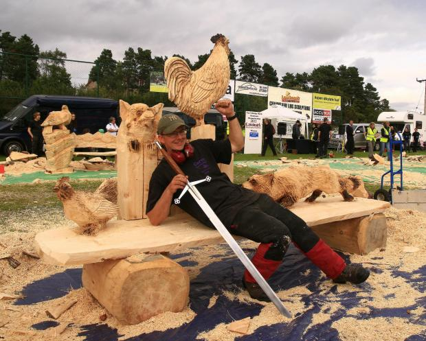 Forestry Journal: Early Morning Alarm Call which is a carve of a fox getting into a hen run, chasing the hen, with a pig looking over the fence. This was a winner at Carve Carrbridge 2012.