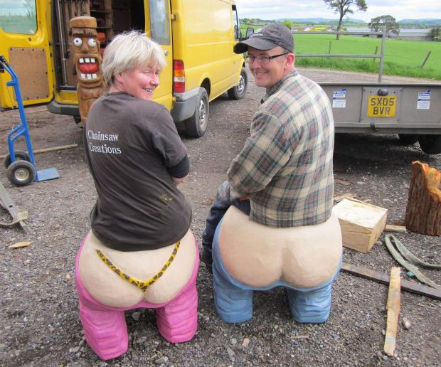 Forestry Journal: Mairi and Iain model the Love Your Bum seat carves which are now at Landmark Carrbridge.