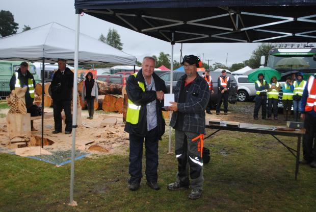 Forestry Journal: Iain picking up his People's Choice award at Carve Carrbridge 2019.