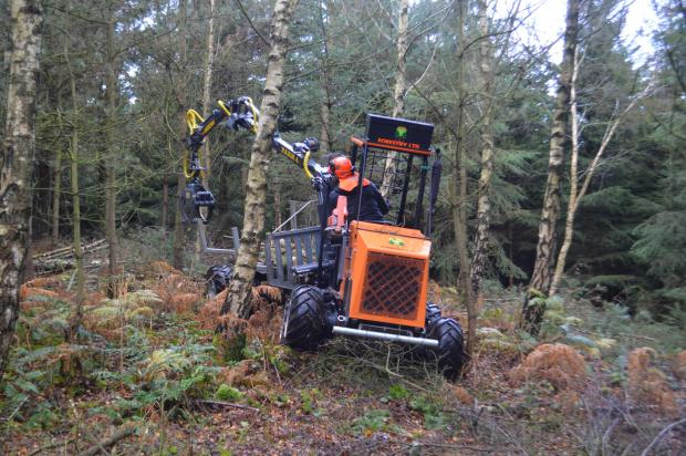 "Forestry Journal: Though it's easy to jump in and out, one disadvantage of the Logbullet's lightweight design is that the cab doesn't offer much protection from the elements. Mike said it's not so bad as long as the rain is ""coming straight down""."