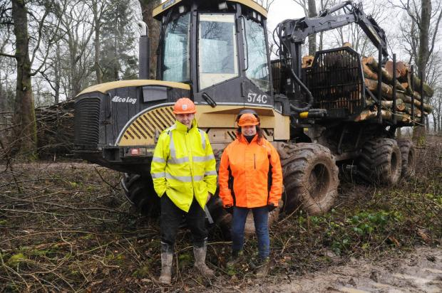 Forestry Journal: Dave Lister of L&P Forestry and Euroforest's site safety coordinator manager, with Judith Peachey, in front of Dave's Ecolog 574C forwarder.