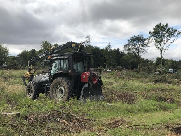 Forestry Journal: Valtra T130 tractor with Botex 560 roof-mounted crane and Igland double-drum 9002 winch.
