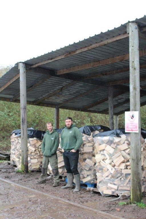 Forestry Journal: Richard and Tom make sure the logs are stacked properly.
