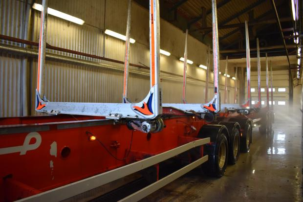 Forestry Journal: Another Göransson trailer – with ExTe bunks – is sprayed clean in the company washroom and soon ready to be sent out to collect another load.