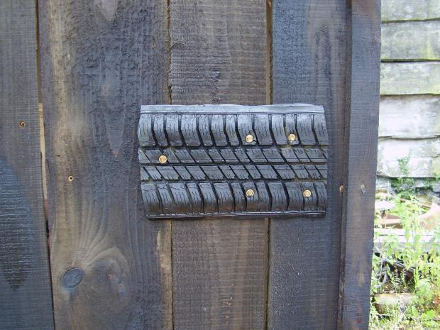 Forestry Journal: Recycled silage tire hinge.