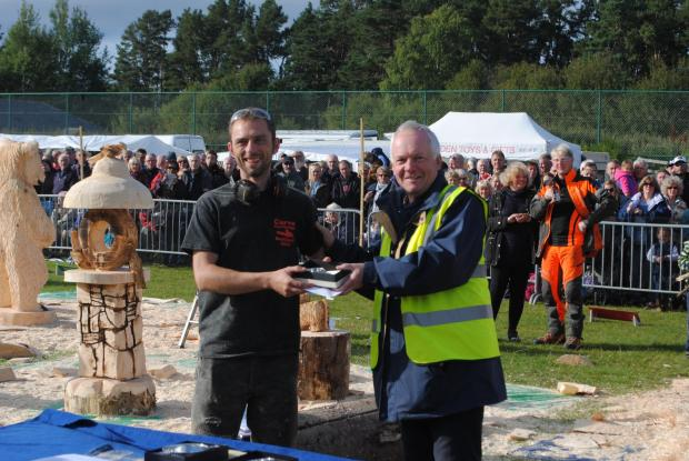Forestry Journal: Garry receiving his third place prize at Carve Carrbridge 2015.