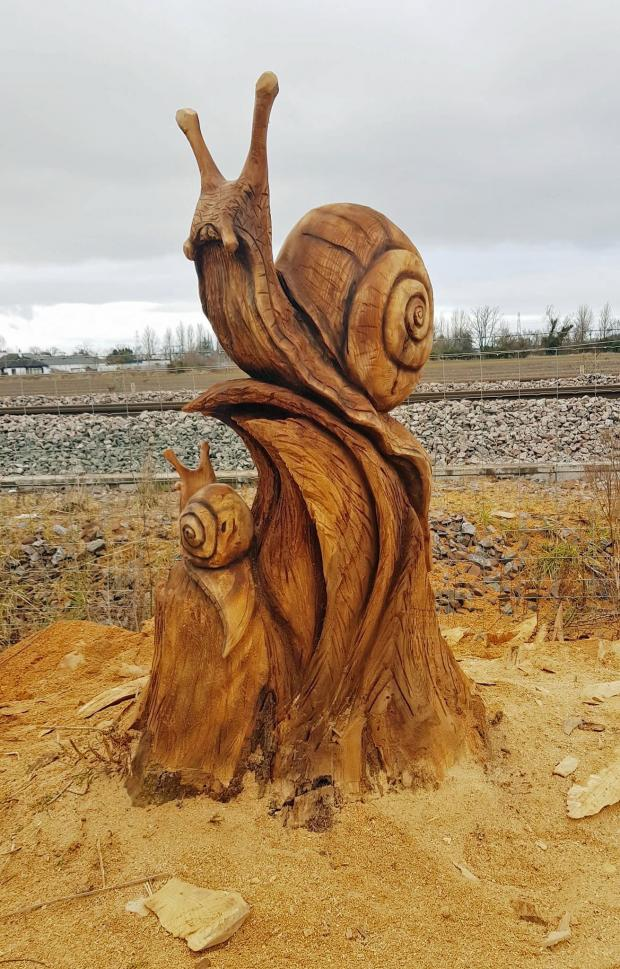 Forestry Journal: The snail carving which is located at the side of the main Inverness-to-Aberdeen railway line at Forres.