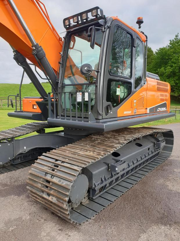 Forestry Journal: Ready for collection - the Doosan with forestry guarding, track guides, window grills and side guarding.